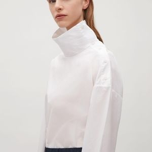 Unique COS blouse with high button-up collar